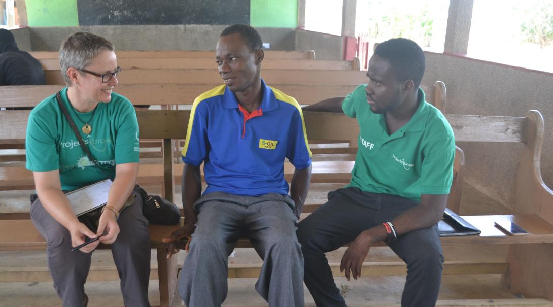 Projects Abroad volunteer doing a social work project shares ideas with local staff in Ghana.